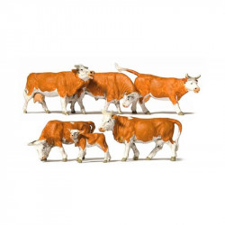 Six vaches marrons et blanches