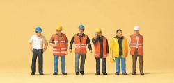 Ouvriers avec gilets de sécurité