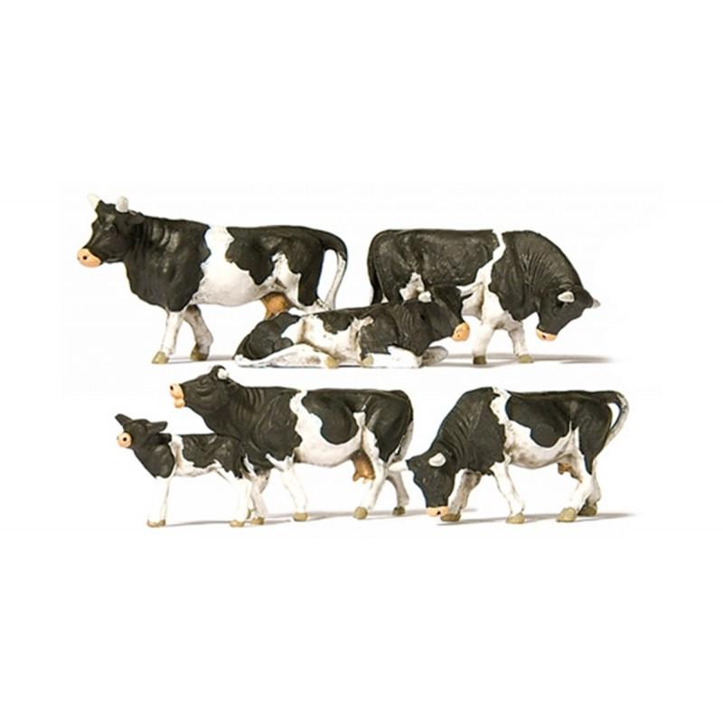 Six vaches noires et blanches